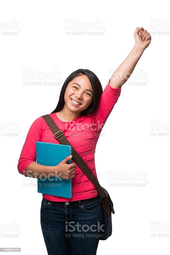 Smiling schoolgirl cheering stock photo