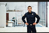 Smiling security guard standing indoors