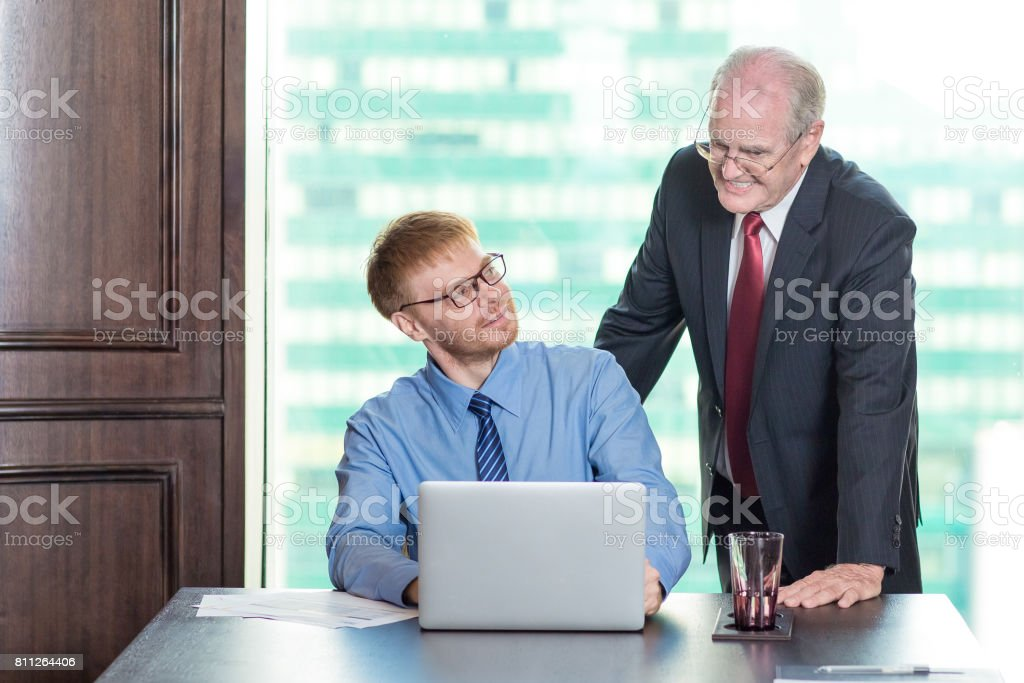 Smiling Senior Boss Consulting Colleague stock photo