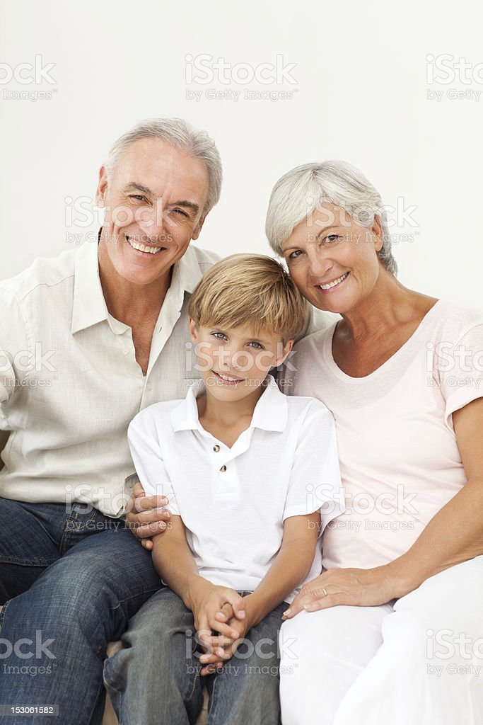 Smiling Senior Couple And Young Boy royalty-free stock photo