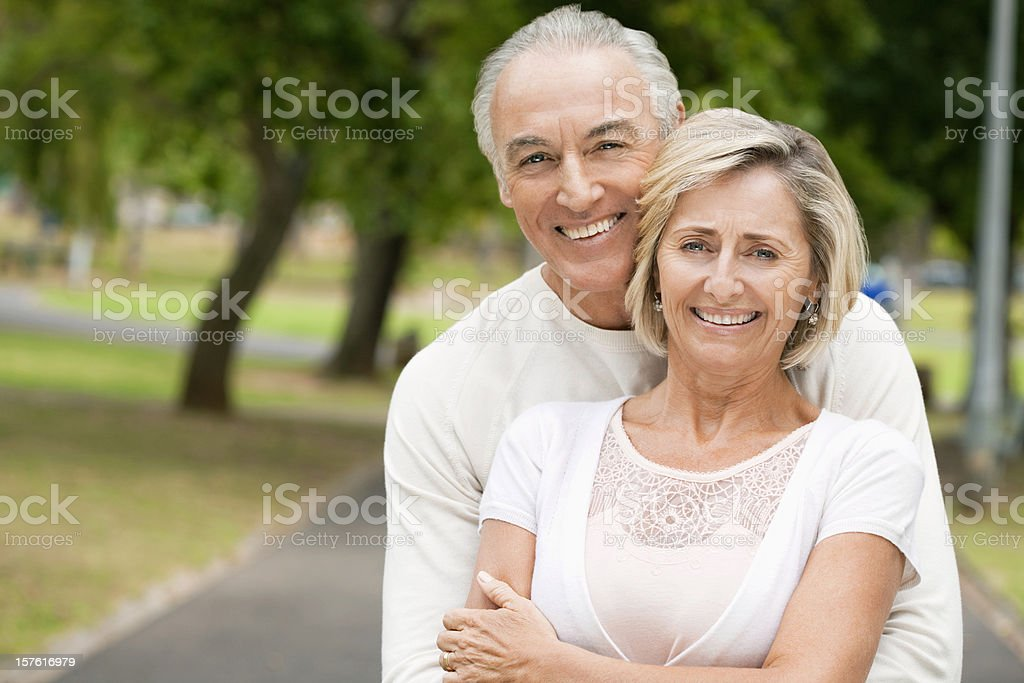 Smiling Senior Couple in a Park royalty-free stock photo