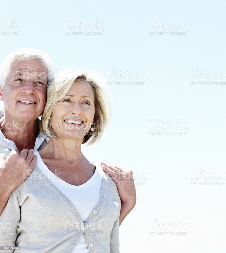 Smiling senior couple looking away while outdoors royalty-free stock photo