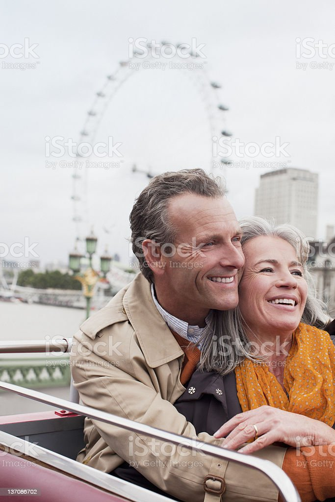 Smiling senior couple on double decker bus in London royalty-free stock photo