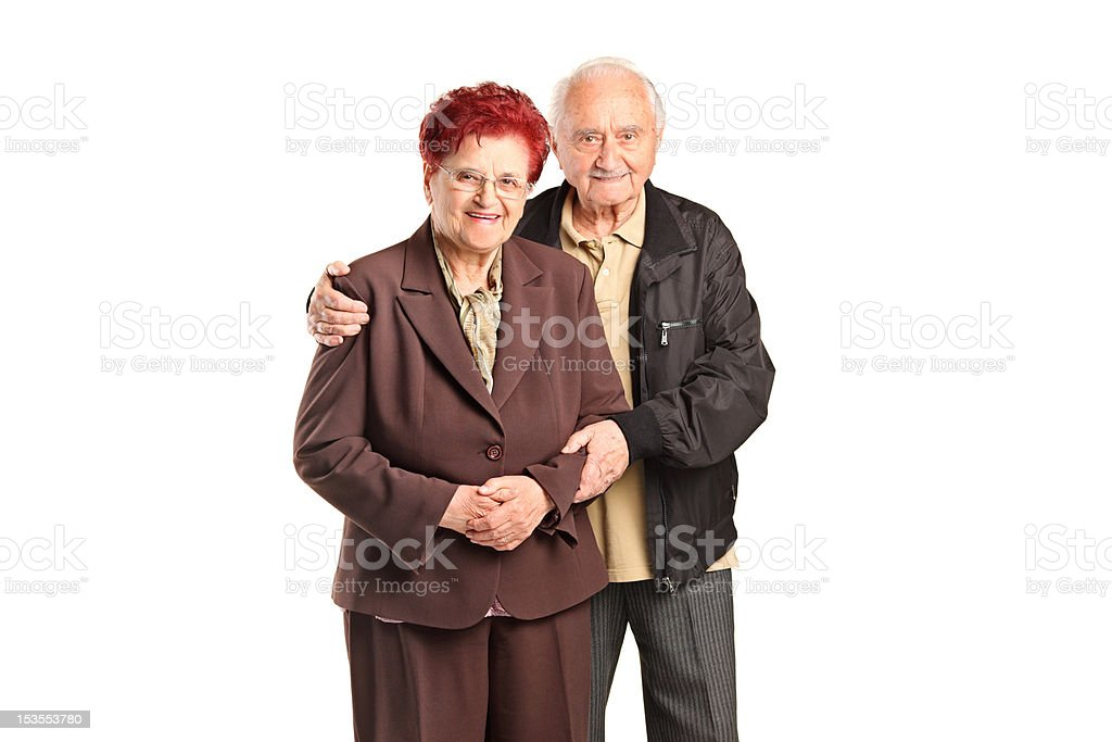 Smiling senior couple posing royalty-free stock photo