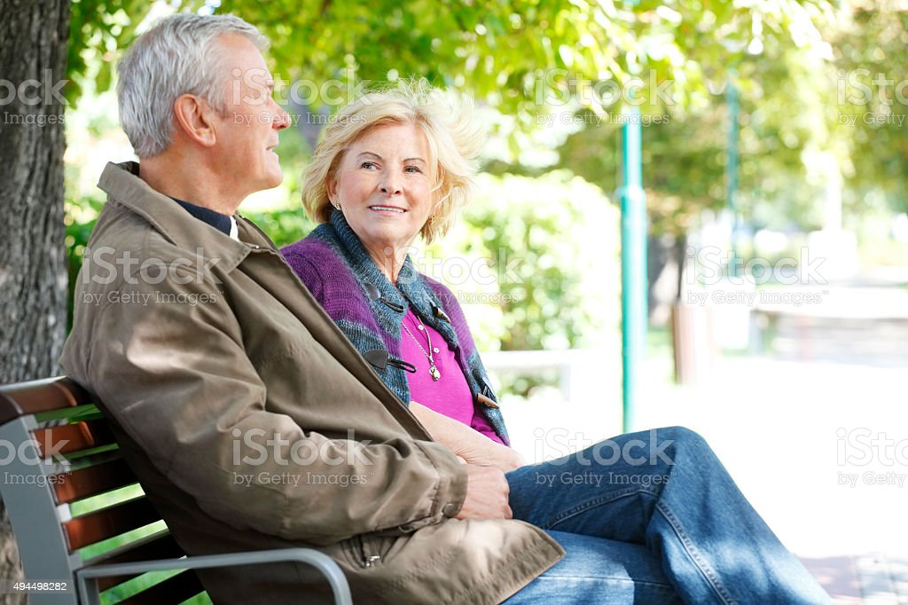 Smiling senior couple relaxing outdoor stock photo
