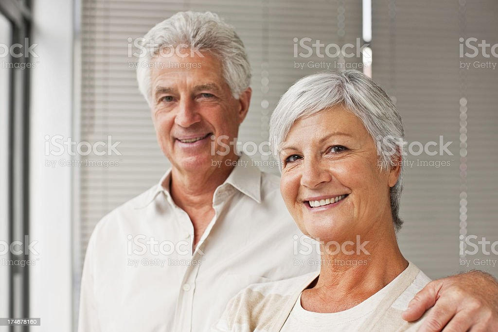 Smiling senior couple standing together royalty-free stock photo