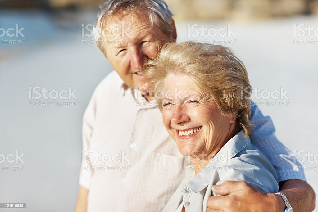 Smiling senior couple together outdoors royalty-free stock photo