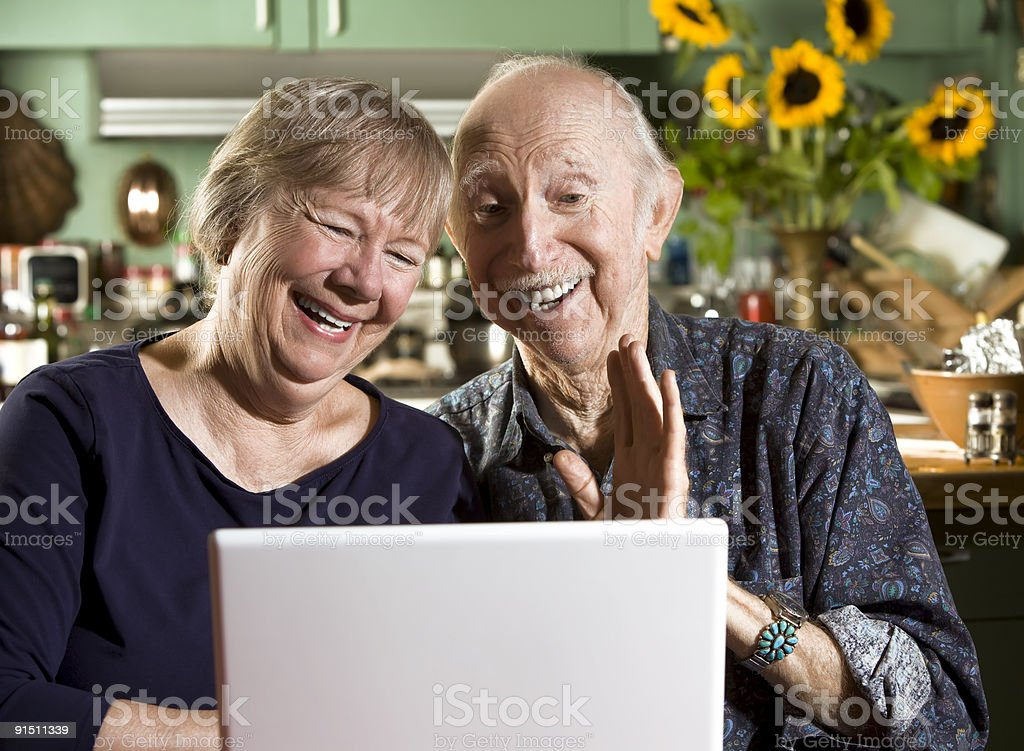 Smiling Senior Couple with a Laptop Computer royalty-free stock photo