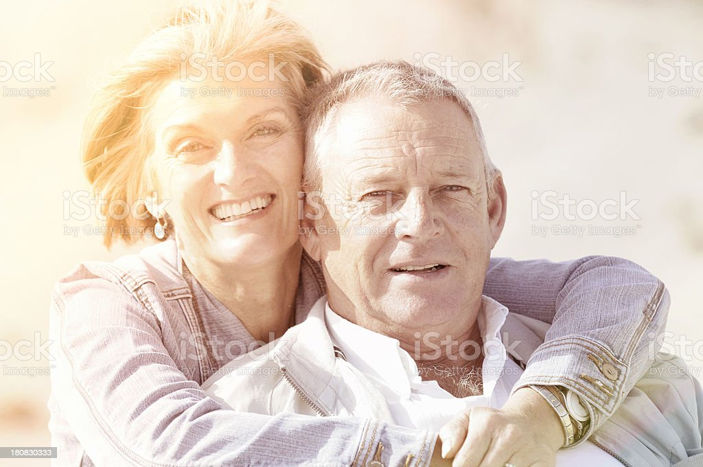 Smiling senior couple with sun flare royalty-free stock photo