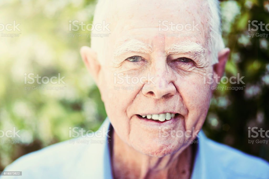 Smiling senior in the sunshine stock photo