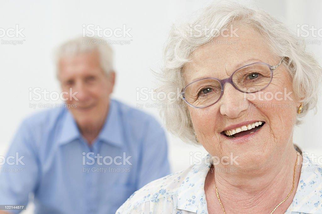 Smiling senior lady with husband stock photo