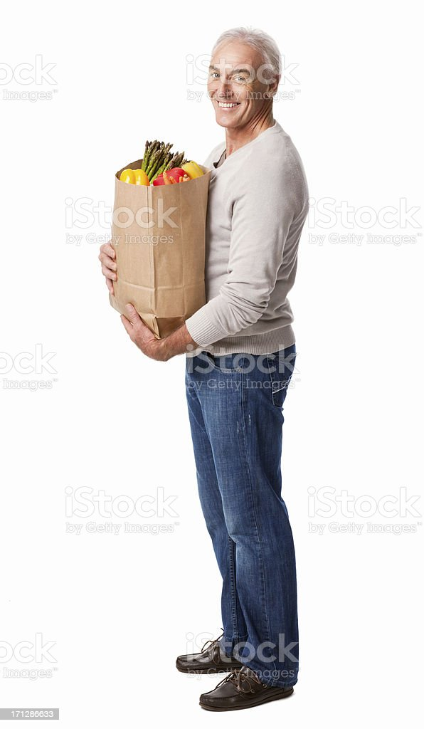 Smiling Senior Man Holding a Bag Of Groceries - Isolated royalty-free stock photo