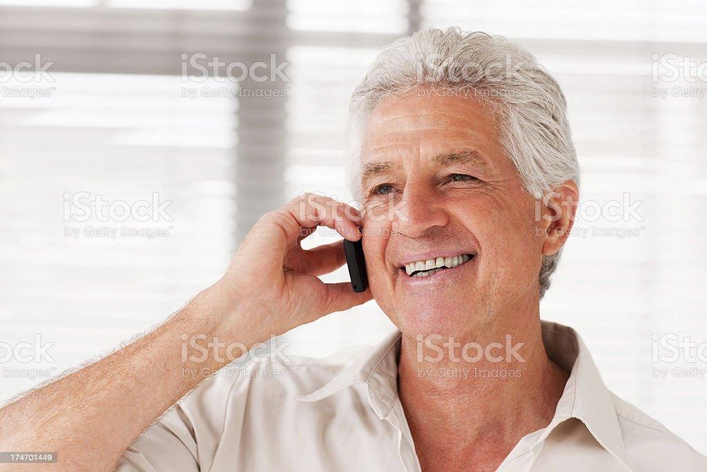 Smiling senior man talking on cellphone royalty-free stock photo