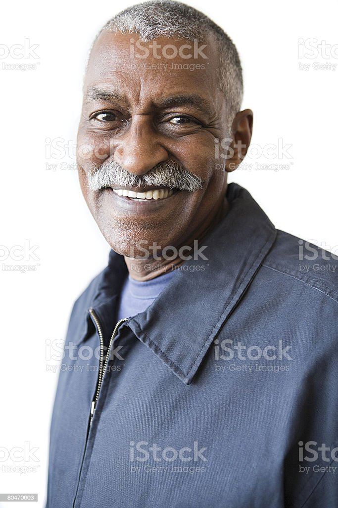 Smiling senior man with a mustache stock photo