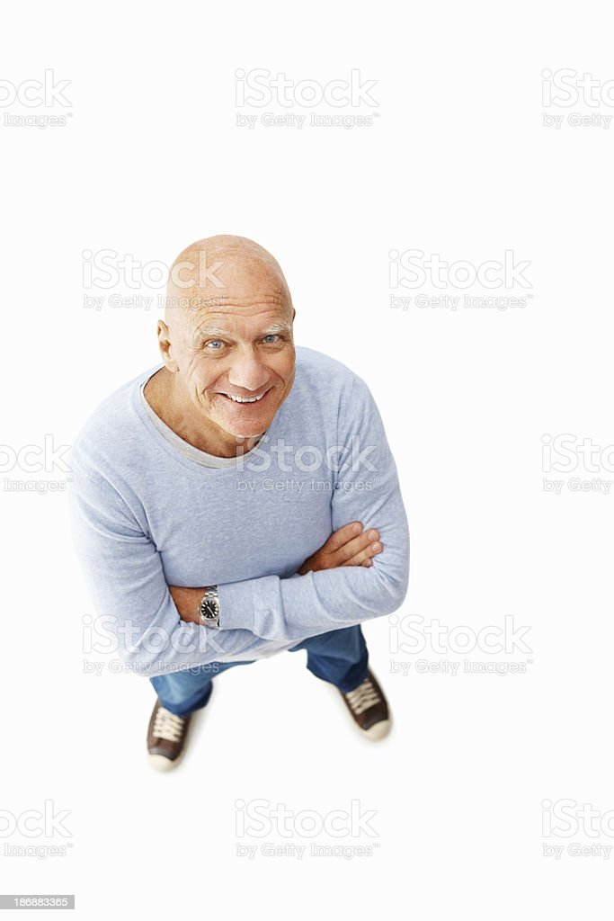 Smiling senior man with hands folded against white royalty-free stock photo