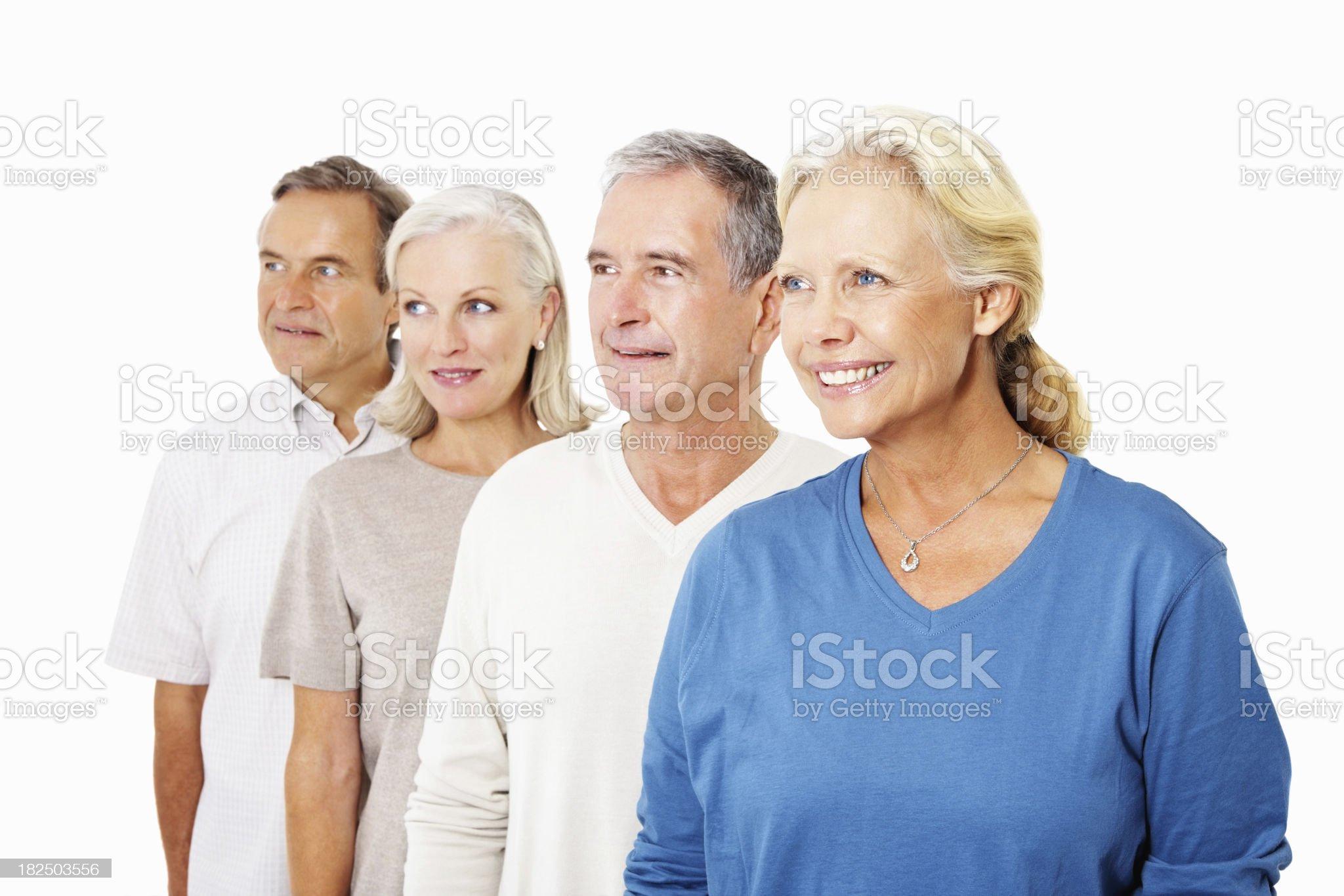 Smiling senior people looking at something interesting royalty-free stock photo