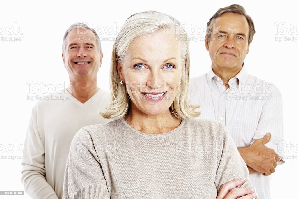 Smiling senior woman and men standing together against white royalty-free stock photo