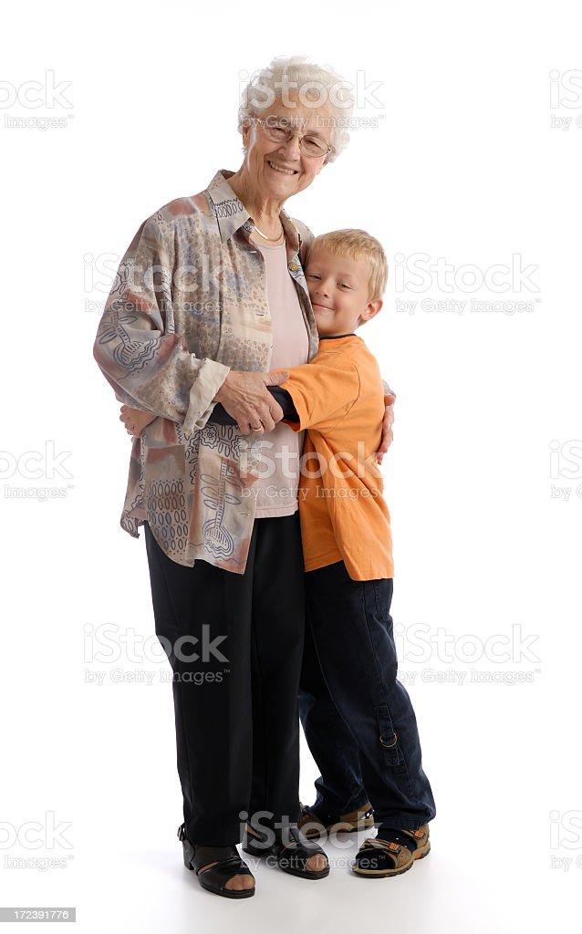 Smiling senior woman hugging smiling little boy royalty-free stock photo