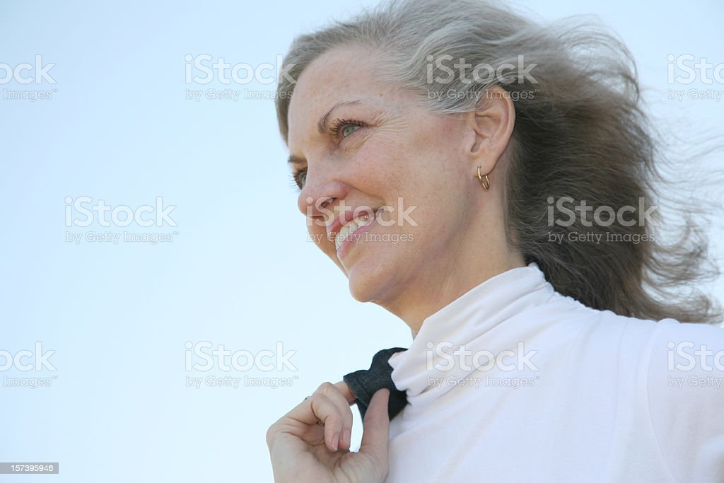 Smiling Senior Woman Looking Ahead To The Future royalty-free stock photo