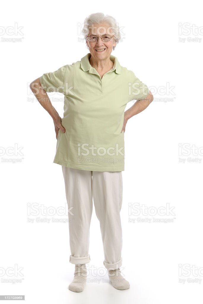 Smiling senior woman with arms on hips in an exercise pose royalty-free stock photo