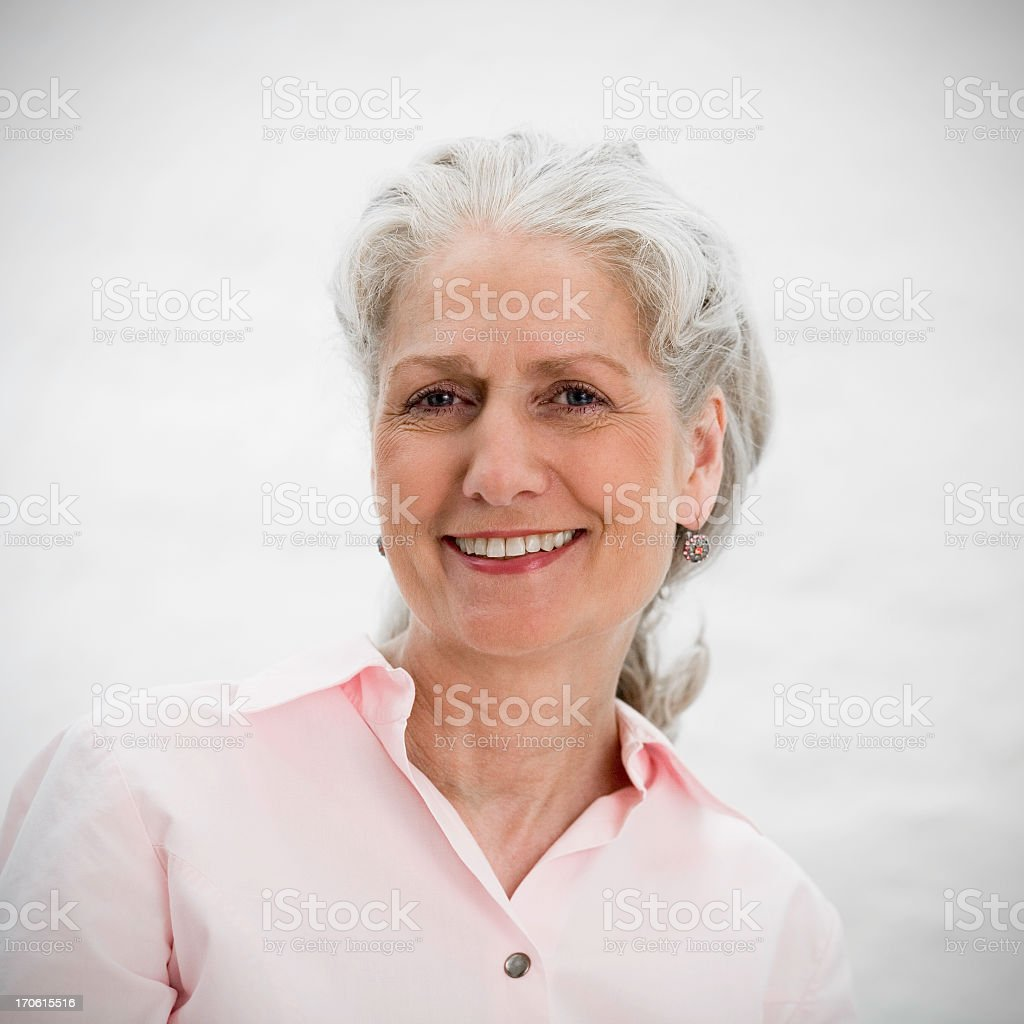 A smiling senior woman with gray hair royalty-free stock photo