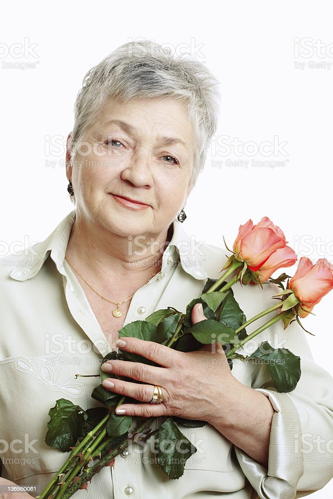 Smiling Senior Woman with Roses royalty-free stock photo