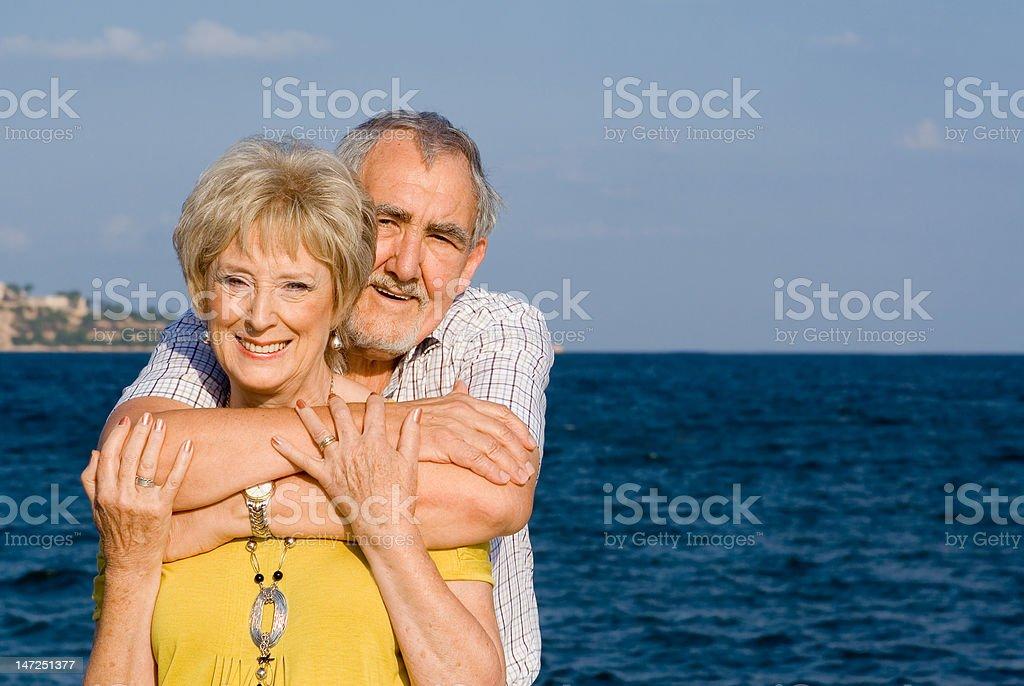 smiling seniors on vacation royalty-free stock photo