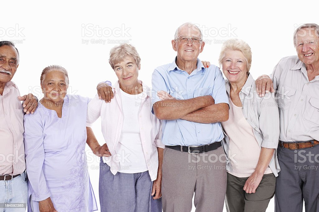 Smiling seniors standing together stock photo