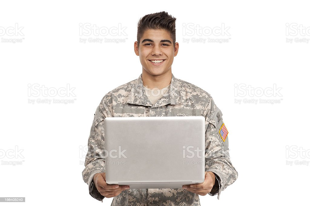 Smiling serviceman holding a laptop royalty-free stock photo