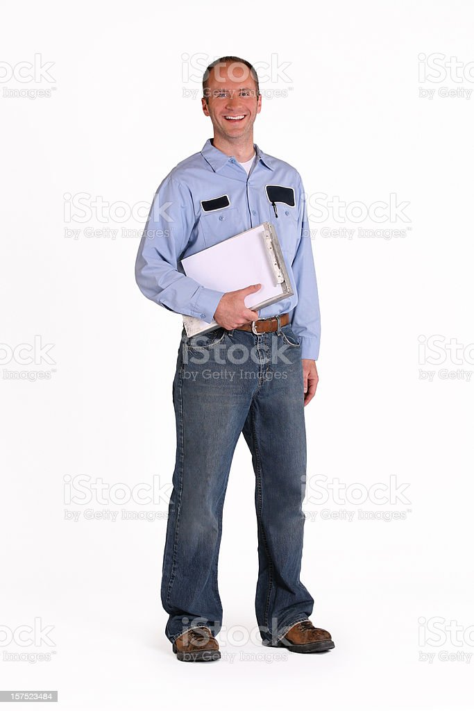 Smiling serviceman holding clipboard with document royalty-free stock photo