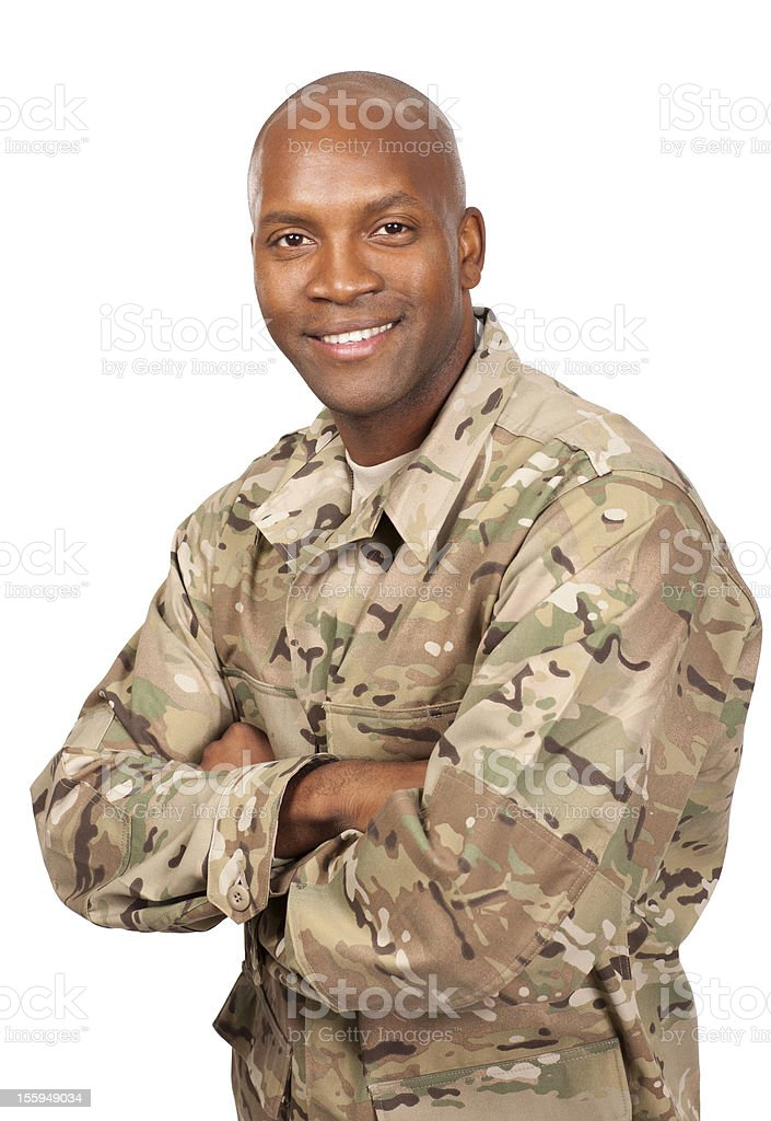 Smiling serviceman with his arms crossed stock photo