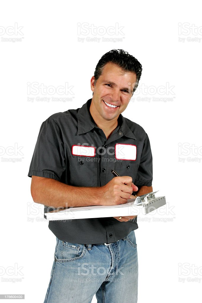 Smiling serviceman writing on clipboard on white background stock photo