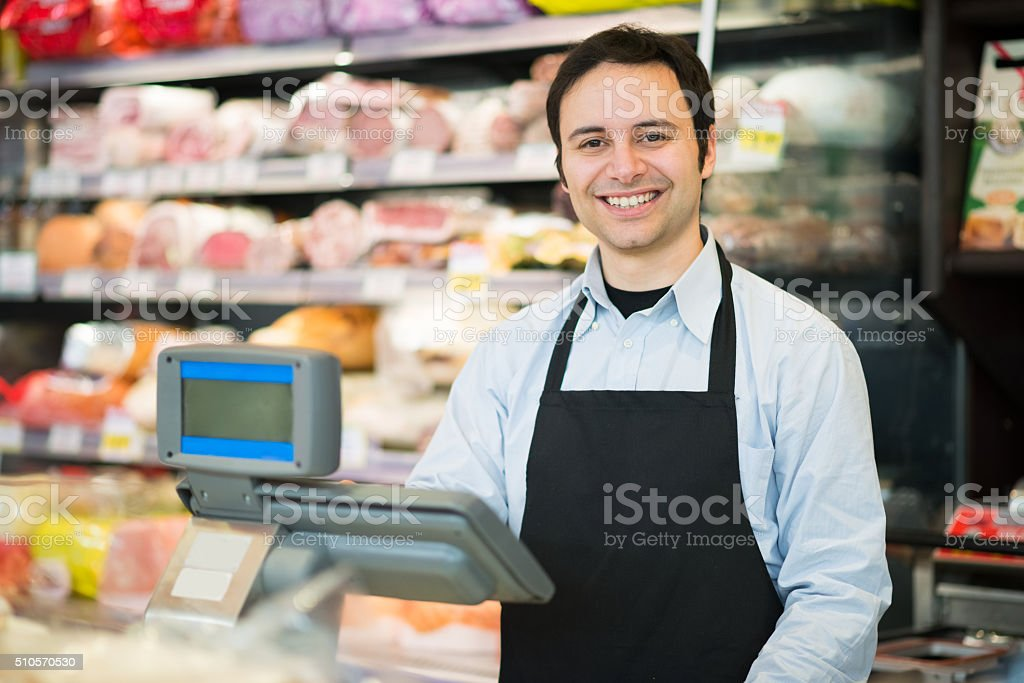 Smiling shopkeeper stock photo