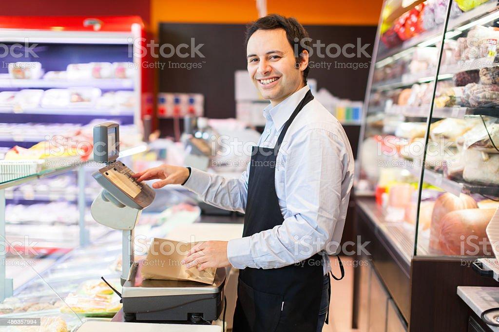 Smiling shopkeeper portrait stock photo