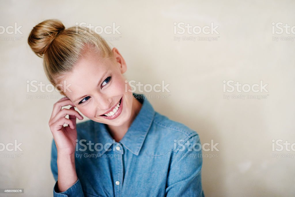 Smiling shyly stock photo