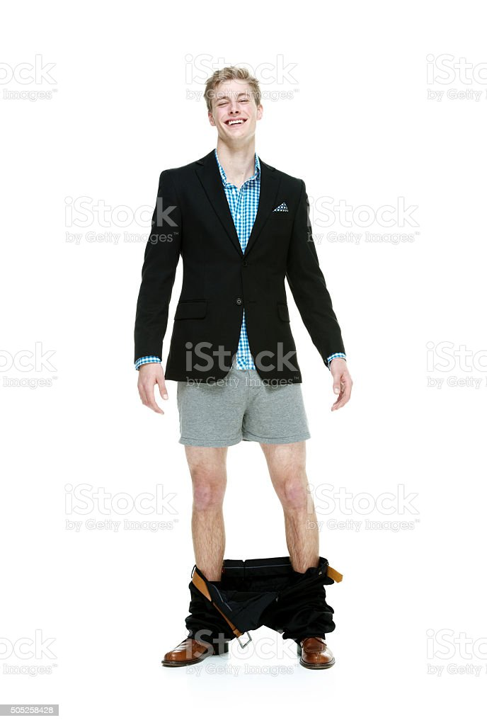 Smiling smart casual man caught with his pants down stock photo