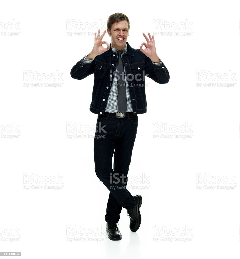 Smiling smart casual man showing ok sign stock photo