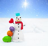 Smiling snowman, Christmas decorations and snowfall