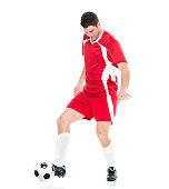 Smiling soccer player dribbling