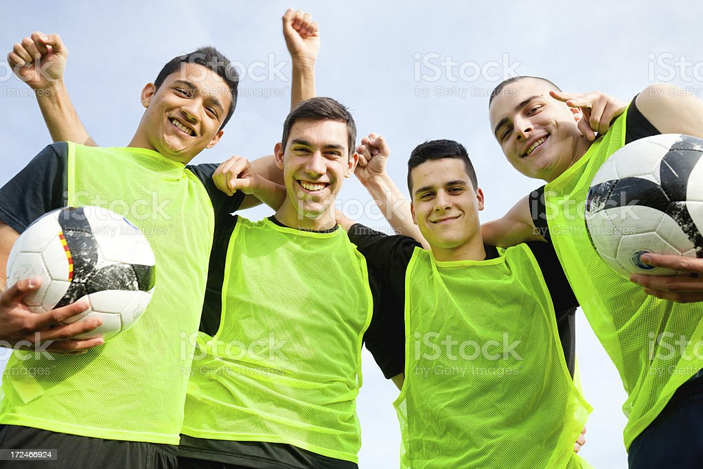 Smiling soccer team makes victorious hand gestures royalty-free stock photo
