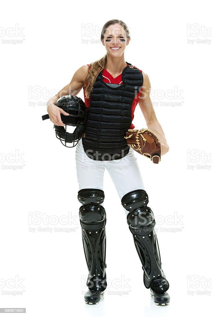Smiling softball player standing stock photo