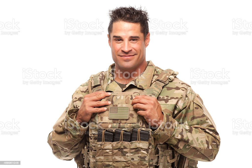 Smiling soldier against white background stock photo