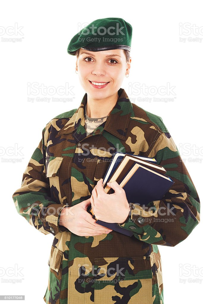 Smiling soldier girl in the military uniform stock photo