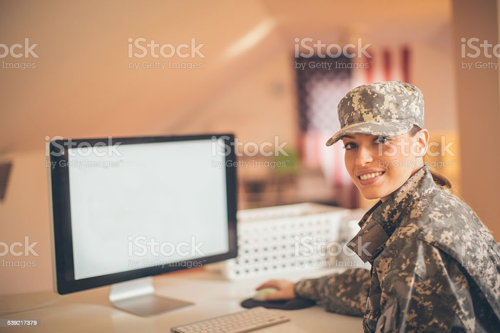 Smiling soldier in the office stock photo