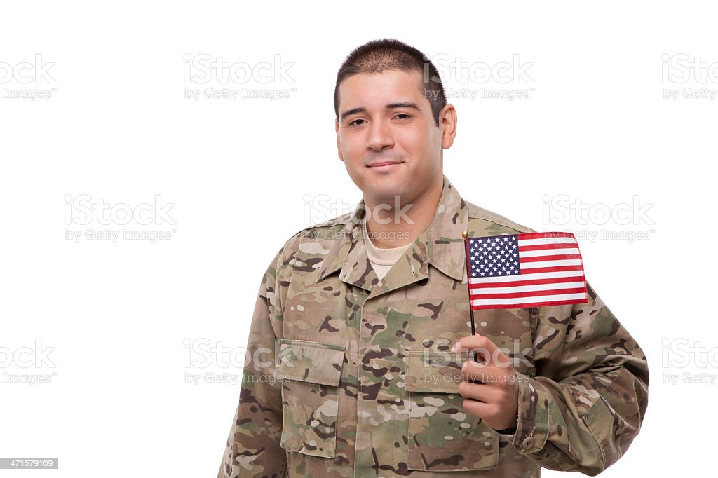Smiling soldier posing with an American flag royalty-free stock photo