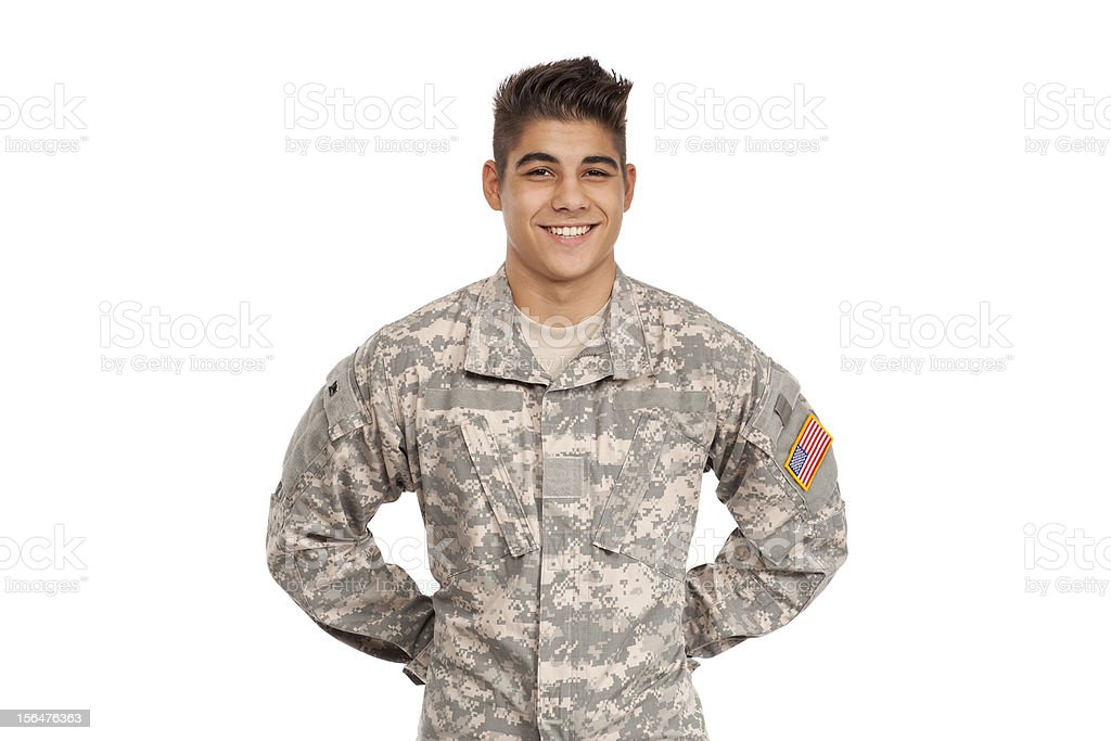 Smiling soldier standing with hands behind back royalty-free stock photo