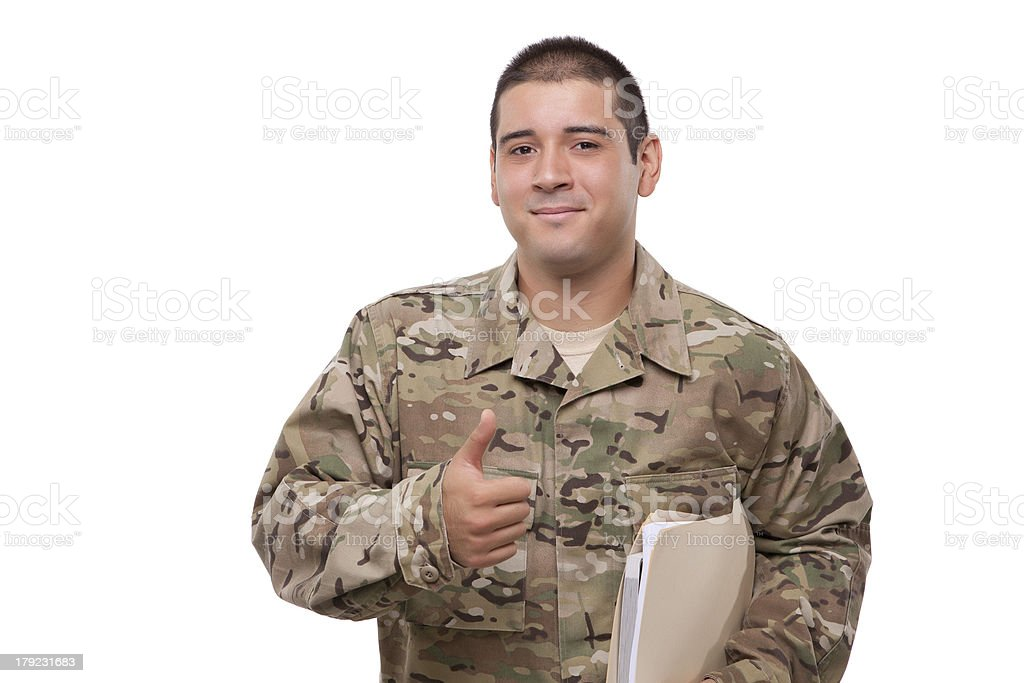 Smiling soldier with documents gesturing thumbs up royalty-free stock photo