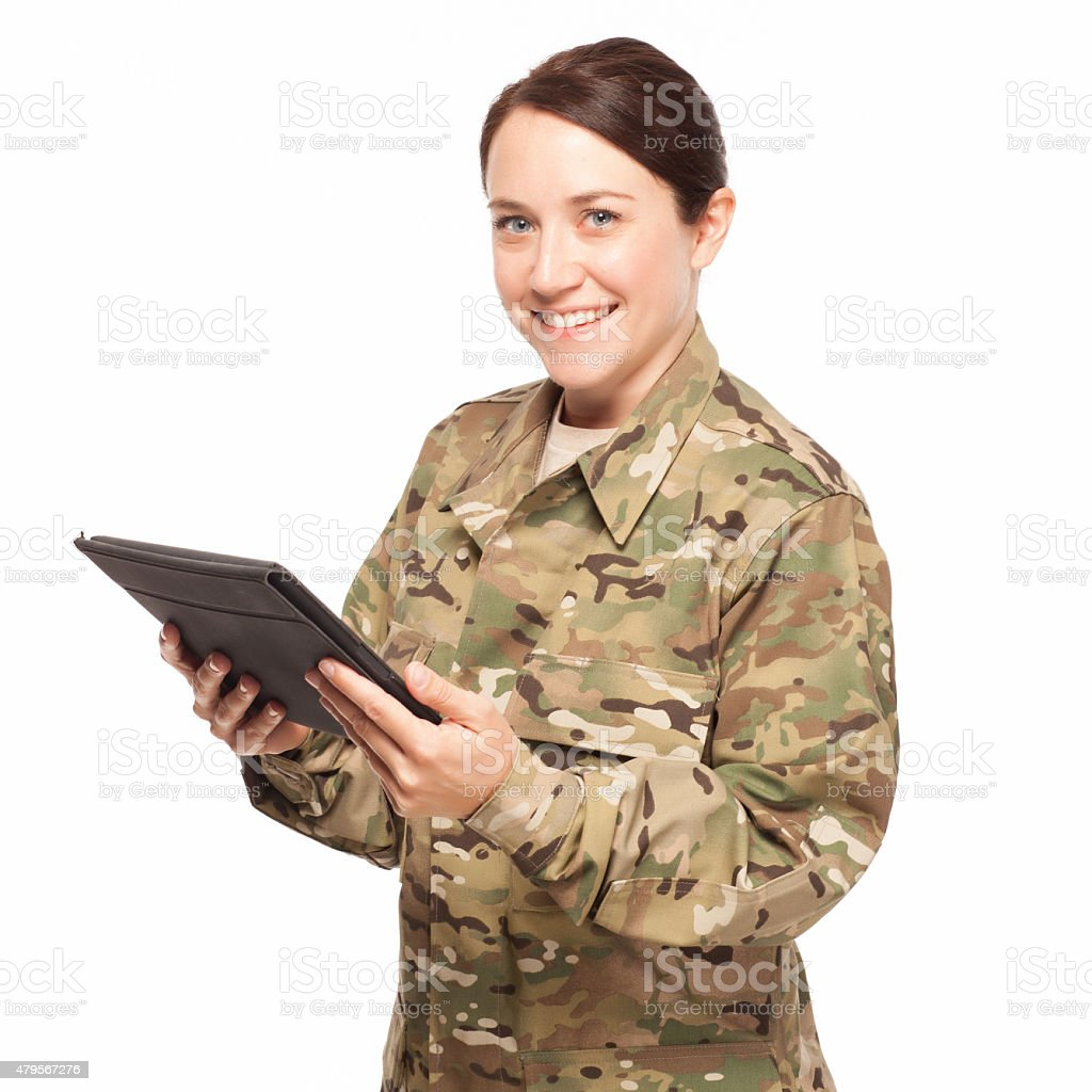 Smiling soldier with tablet. stock photo