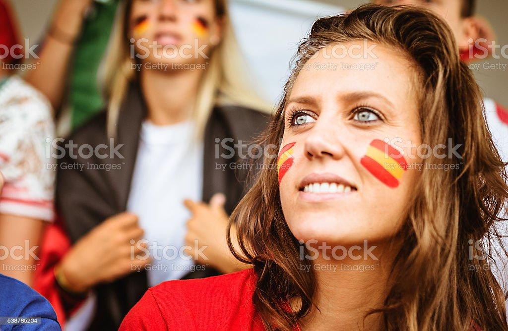 smiling spanish supporter at stadium stock photo