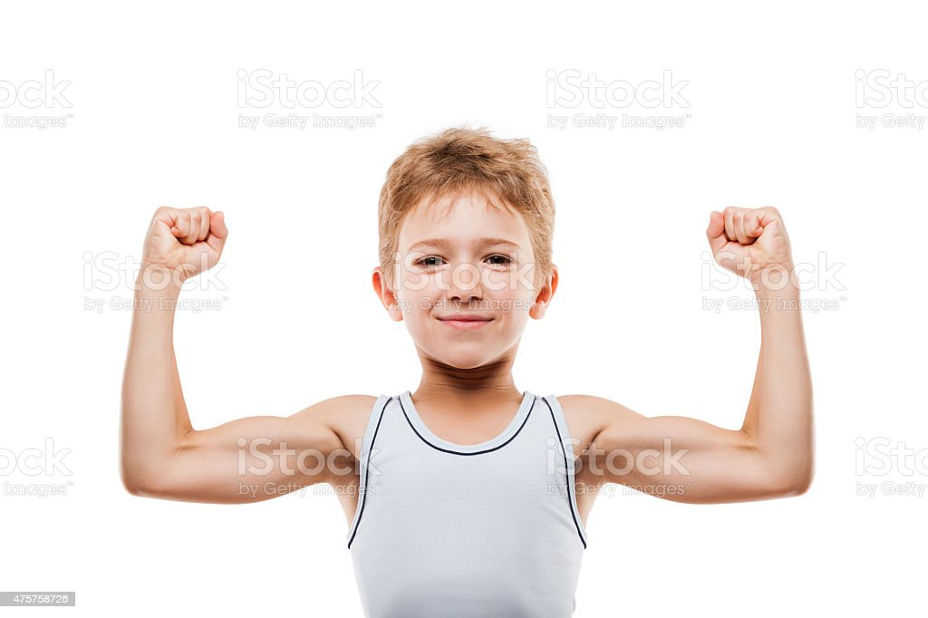 Smiling sport child boy showing his hand biceps muscles strength stock photo